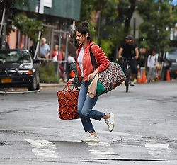 Selena Gomez runs in the rain on the set of Woody Allen's untitled drama in the West Village. 19 Sep 2017 Pictured: Selena Gomez. Photo credit: STB / MEGA TheMegaAgency.com +1 888 505 6342