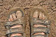 A pair of muddy feet at the 2005 Glastonbury festival.