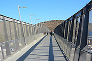 People on the Pedestrian Bridge Over the Highway Near the California Mexico Border