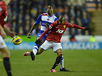 Football - Barclays Premier League - Reading vs. Manchester United<br /> Mikele Leigertwood of Reading tackles Ashley Young of Manchester United at the Madejski Stadium, Reading
