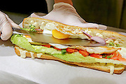 Grilled Chicken Breast and egg sandwich in a baguette roll