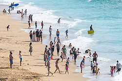 Sunny weather brings out the holidaymakers to Fistral Beach in Newquay, Cornwall.