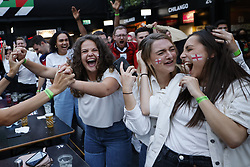 © Licensed to London News Pictures. 07/07/2021. London, UK. England supporters react at Boxpark in Croydon, south London as they watch the EURO 2020 semi-final between England and Denmark in a giant TV screen. Photo credit: Peter Macdiarmid/LNP
