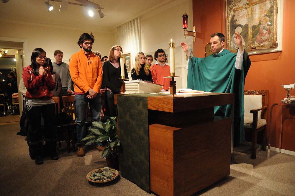 Fr. Brian Welter ends mass with a final prayer at Calvert House at University of Chicago. With Sunday services at 11am, 5pm, and 9pm, Calvert offers the only Catholic masses on the Hyde Park campus. The late mass accommodates student's academic and sports commitments.