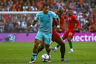Portugal midfielder Danilo (13) challenges Netherlands forward Memphis Depay (Lyon) during the UEFA Nations League match between Portugal and Netherlands at Estadio do Dragao, Porto, Portugal on 9 June 2019.
