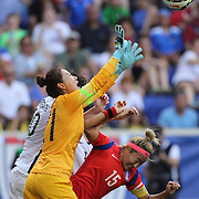 Korean Republic goalkeepr Jung-mi Kim and defender So-hyun Cho clear from Abby Wambach, U.S. Women's National Team, during the U.S. Women's National Team Vs Korean Republic, International Soccer Friendly in preparation for the FIFA Women's World Cup Canada 2015. Red Bull Arena, Harrison, New Jersey. USA. 30th May 2015. Photo Tim Clayton