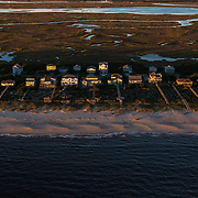 Oak Island, NC-October, 23 2016: Homes line the beach on Oak Island,  30 miles south of Wilmington,  on the coast of North Carolina. Recently, the Coastal Resources Commission has lifted a restriction allowing the line of construction on the island to move closer to the coast despite current projections on sea level rise. CREDIT: LOGAN R CYRUS FOR THE NEW YORK TIMES