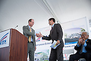 Metropolitan Transportation Commission Executive Director Steve Heminger, left, shakes hands with Silicon Valley Leadership Group CEO Carl Guardino during VTA's BART Silicon Valley Extension Celebration in San Jose, California, on August 20, 2014. (Stan Olszewski/SOSKIphoto)