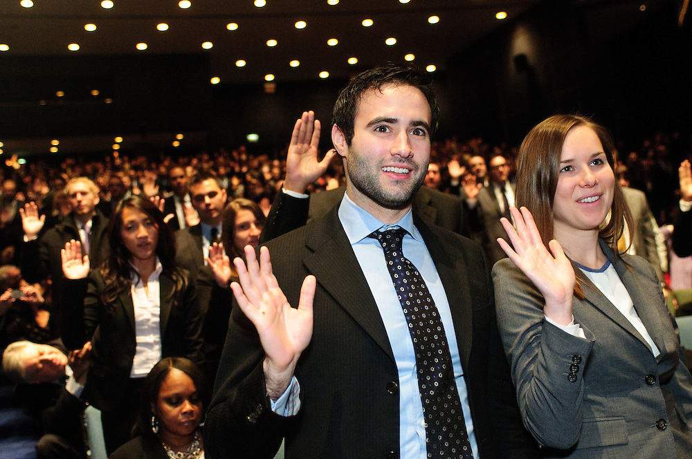 Taylor N. Landesman (center) and Molly E. Carney (right) recite the Attorney's Oath as the Supreme Court of Illinois conducts a 1st District Admission Ceremony for new attorneys at the Arie Crown Theater on Thursday, November 1st. They are among more than 2,100 new attorneys admitted to practice during several ceremonies throughout the State, bringing the total number of licensed Illinois attorneys to approximately 91,600 according to the Illinois Supreme Court. © 2012 Brian J. Morowczynski ViaPhotos