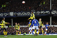 Clevid Dikamona of Dagenham & Redbridge heads the ball clear. The Emirates FA cup, 3rd round match, Everton v Dagenham & Redbridge at Goodison Park in Liverpool on Saturday 9th January 2016.<br /> pic by Chris Stading, Andrew Orchard sports photography.