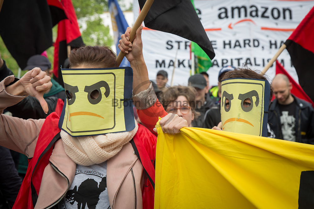 """Berlin, Germany - 24.04.2018<br /> <br /> Striking Amazon employees from Poland, Spain and Germany are protesting in Berlin for fair wages and pay agreements. The reason for the union protest was the presentation of the Axel Springer Award 2018 to Amazon founder Jeff Bezos for """"his visionary entrepreneurship"""".  Union ver.di chairman Frank Bsirske and the party chairmen Andrea Nahles (SPD) and Bernd Riexinger (Left Party) also participated the protests. <br /> <br /> Streikende Angestellte von Amazon aus aus Polen, Spanien und Deutschland protestieren in Berlin fuer faire Loehne und Tarifvertraege. Anlass des Gewerkschaftsprotests war die Verleihung des Axel Springer Award 2018 an Amazon-Gruender Jeff Bezos fuer """"sein visionaeres Unternehmertum"""". Neben ver.di Chef Frank Bsirske beteiligten sich auch die Parteivorsitzenden Andrea Nahles (SPD) und Bernd Riexinger (Linkspartei). <br /> <br /> Photo: Bjoern Kietzmann"""