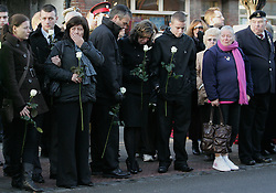 © under license to London News Pictures.  16/11/10..The parents (fourth and fifth from left - confirmed) and close friends of Senior Aircraftman Scott Hughes, a British airman killed in a boating accident in Cyprus, grieve at his repatriation, Wootton Bassett, Wiltshire. ..SAC Scott Hughes, 20, from North Wales, a gunner from Number 1 Squadron Royal Air Force Regiment, was in Cyprus ahead of returning home after six months' service in Afghanistan. ..He died on November 7 from injuries sustained when he was struck by a powerboat while swimming in the sea...Picture credit should read: Rebecca Mckevitt/London News Pictures