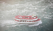 SHOT 10/21/17 3:12:13 PM - The Maid of the Mist is a boat tour of Niagara Falls, starting and ending on the American side, crossing briefly into Ontario during a portion of the trip. (The actual boats used are also named Maid of the Mist, followed by a different Roman numeral in each case.) The boat starts off at a calm part of the Niagara River, near the Rainbow Bridge, and takes its passengers past the American and Bridal Veil Falls, then into the dense mist of spray inside the curve of the Horseshoe Falls, also known as the Canadian Falls. The tour starts and returns on the U.S. side of the river. Buffalo, N.Y. is the second most populous city in the state of New York and is located in Western New York on the eastern shores of Lake Erie and at the head of the Niagara River. By 1900, Buffalo was the 8th largest city in the country, and went on to become a major railroad hub, the largest grain-milling center in the country and the home of the largest steel-making operation in the world. The latter part of the 20th Century saw a reversal of fortunes: by the year 1990 the city had fallen back below its 1900 population levels. (Photo by Marc Piscotty / © 2017)
