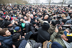 """© Licensed to London News Pictures . 18/03/2018 . London , UK . TOMMY ROBINSON (centre, falling down) arrives . Alt-right groups , including Generation Identity , and antifascist opponents , demonstrate at Speakers' Corner in Hyde Park where Tommy Robinson reads a speech by Generation Identity campaigner Martin Sellner . Along with Brittany Pettibone , Sellner was due to deliver the speech last week but the pair were arrested and detained by police when they arrived in the UK , forcing them to cancel an appearance at a UKIP """" Young Independence """" youth event , which in turn was reportedly cancelled amid security concerns . Photo credit: Joel Goodman/LNP"""