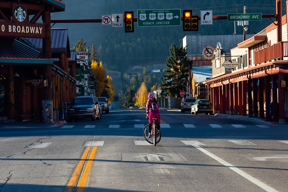 Heather Goodrich waits a the downtown light to head up to the singletrack in the Cache Creak Drainage.