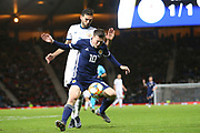 Scotland midfielder Callum McGregor (10) (Celtic) holds off the challenge from Magomed Ozdoev of Russia (7) (Zenit St Petersburg) during the UEFA European 2020 Qualifier match between Scotland and Russia at Hampden Park, Glasgow, United Kingdom on 6 September 2019.