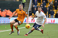 Wolverhampton Wanderers striker Bjorn Sigurdarson and Preston North End defender Bailey Wright  during the Sky Bet Championship match between Wolverhampton Wanderers and Preston North End at Molineux, Wolverhampton, England on 13 February 2016. Photo by Alan Franklin.