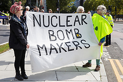 London, UK. 4 September, 2019. Anti-nuclear activists protest outside ExCel London on the third day of a week-long carnival of resistance against DSEI, the world's largest arms fair. The third day's protests were organised by the Campaign for Nuclear Disarmament (CND) and Trident Ploughshares.