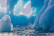 Close-up of the blue ice of an iceberg on the Arctic Ocean, Svalbard, Norway, The Arctic