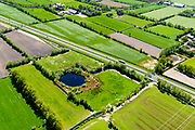 Nederland, Friesland, Centrale As, 07-05-2018; provinciale weg 356 (N356), Sintrale As of de Centrale As, tussen Nijega en Dokkum.<br /> Lokatie ter hoogte van Burgum, Pingo ruine. Pingoruïne, overblijfsel van een pingo (ringvormige krater uit de ijstijd).<br /> New local motorway Friesland<br /> luchtfoto (toeslag op standaard tarieven);<br /> aerial photo (additional fee required);<br /> copyright foto/photo Siebe Swart