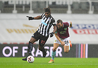 Football - 2021 / 2021 Premier League - Newcastle United vs Burnley - St Jame's Park<br /> <br /> Allan Saint-Maximin of Newcastle United vies with Phil Bardsley of Burnley FC<br /> <br /> <br /> COLORSPORT/BRUCE WHITE