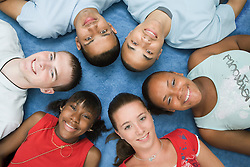 Multiracial group of teenagers smiling,