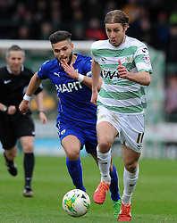 Yeovil Town's Sam Foley is tackled by Chesterfield's Sam Morsy - Photo mandatory by-line: Harry Trump/JMP - Mobile: 07966 386802 - 03/04/15 - SPORT - FOOTBALL - Sky Bet League One - Yeovil Town v Chesterfield - Huish Park, Yeovil, England.