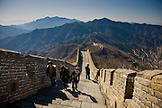 Tourists walk the ancient Great Wall of China at Mutianyu, north of Beijing (formerly Peking), China
