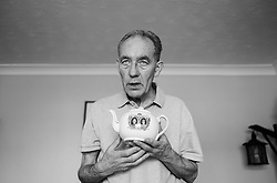 © Licensed to London News Pictures. 09/04/2014<br /> These photographs have been converted to black and white<br /> <br /> Durham, United Kingdom<br /> <br /> Parkinson's Disease sufferer David Forsyth from Brandon, County Durham holds one of the many items in his royal porcelain collection that he has collected for many years. <br /> <br /> Parkinson's is a long-term neurological condition that affects the way the brain co-ordinates body movements including walking, talking and writing and affects both men and women.<br /> <br /> Photo credit : Ian Forsyth/LNP