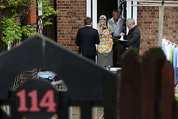 © Licensed to London News Pictures. 05/05/2013. London, UK. Detectives question locals at the scene where a 30 year-old man was stabbed to death at a flat in Jessam Avenue, Clapton, east London, on Saturday night.Two men have been arrested on suspicion of murder. Photo credit : Peter Kollanyi/LNP