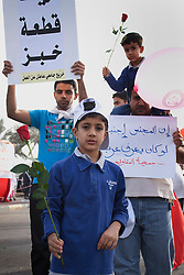 © under license to London News Pictures. 21/02/2011. Protesters march around Pearl Rounabout in Manama, Bahrain where thousands of people have gathered to protest for government reforms. Photo credit should read Michael Graae/London News Pictures