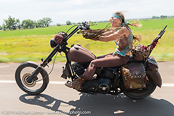 Betsy Huelskamp rides back to Sturgis after the annual Michael Lichter - Sugar Bear Ride hosted by Jay Allen with the Easyriders Saloon during the Sturgis Black Hills Motorcycle Rally. SD, USA. Sunday, August 3, 2014. Photography ©2014 Michael Lichter.