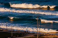 Waves crashing near Clore Beach along the Mediterranean Sea in Tel Aviv, Israel.