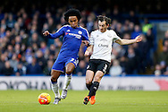 Willian of Chelsea challenges Leighton Baines of Everton. Barclays Premier league match, Chelsea v Everton at Stamford Bridge in London on Saturday 16th January 2016.<br /> pic by John Patrick Fletcher, Andrew Orchard sports photography.