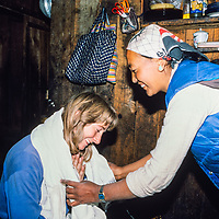 Lakpa Doma sherpa presents a prayer scarf to Meredith Wiltsie in the Khumbu region of Nepal 1986.