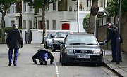 © Licensed to London News Pictures. 30/08/2012. London, UK Police officers carry out a search after a street cleaner has suffered potentially life threatening injuries after being stabbed when disturbing a burglary in Shepherds Bush in West London today 30 August 2012. Photo credit : Stephen Simpson/LNP
