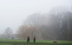 ©Licensed to London News Pictures 01/01/2020<br /> Sidcup ,UK. Early morning dog walkers in the misty fog. New years day foggy weather at Footscray Meadows in Sidcup, South East London this morning.Photo credit: Grant Falvey/LNP