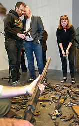 16 April 2014. Jonathan Ferrara Gallery, New Orleans, Louisiana. <br /> L/R; Artists Skyler Fein, Jonathan Ferrara and Deborah Luster at the Jonathan Ferrara Gallery to announce the 'Guns In The Hands Of Artists' project where artists take parts from 190 destroyed weapons acquired by the New Orleans Police department through a buy-back program and convert them into art.  <br /> Photo; Charlie Varley/varleypix.com