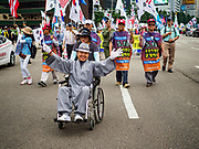 09 JUNE 2018 - SEOUL, SOUTH KOREA: A man in a wheelchair is pushed during a pro-American rally in downtown Seoul. Participants said they wanted to thank the US for supporting South Korea and they hope the US will continue to support South Korea. Many were also opposed to ongoing negotiations with North Korea because they don't think Kim Jong-un can be trusted to denuclearize or to not attack South Korea.     PHOTO BY JACK KURTZ