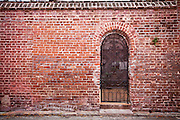 Old brick wall and gate in the historic district of Charleston, SC