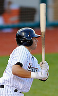 Tim Binkoski of the Crushers drives in a run with a single in the third inning. DAVID RICHARD / CHRONICLE
