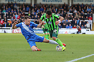 Hartlepool United defender Carl Magnay (2) tackles Andy Barcham midfielder for AFC Wimbledon (17) during the Sky Bet League 2 match between Hartlepool United and AFC Wimbledon at Victoria Park, Hartlepool, England on 25 March 2016. Photo by Stuart Butcher.