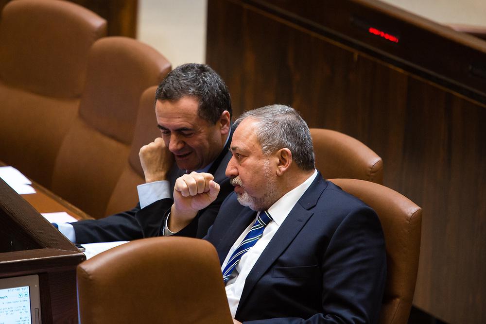 Israel's Defense Minister Avigdor Lieberman (R) speaks with Israel's Minister of Transportation Yisrael Katz at the Knesset, Israel's parliament in Jerusalem, on December 7, 2016.