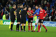 Cardiff city's Craig Bellamy © and Andrew Taylor ® have words with referee David Coote and his assistants at the final whistle.  NPower championship, Cardiff city v Peterborough Utd at the Cardiff city stadium in Cardiff, South Wales on Sat 15th Dec 2012. pic by Andrew Orchard, Andrew Orchard sports photography,