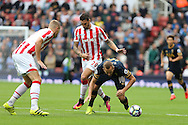 Harry Kane of Tottenham Hotspur is fouled by Geoff Cameron of Stoke City. Premier league match, Stoke City v Tottenham Hotspur at the Bet365 Stadium in Stoke on Trent, Staffs on Saturday 10th September 2016.<br /> pic by Chris Stading, Andrew Orchard sports photography.