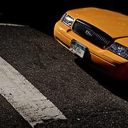 Yellow cab at a stop.