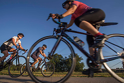 © Licensed to London News Pictures. 25/06/2020. London, UK. Cyclists enjoy the warm conditions in the early morning at Richmond Park in west London. Record temperatures are expected this week as the UK starts to relax lockdown restrictions, introduced earlier this year to prevent the spread of COVID-19.<br /> Photo credit: Marcin Nowak/LNP