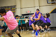 Milpitas High School seniors take down the sophomore class during the tug-of-war competition during the annual Trojan Olympics, where students compete in various unorthodox events for class bragging rights, at Milpitas High School in Milpitas, California, on March 27, 2015. (Stan Olszewski/SOSKIphoto)