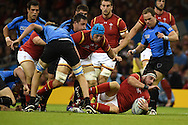 Scott Baldwin of Wales is brought to ground. Rugby World Cup 2015 pool A match, Wales v Uruguay at the Millennium Stadium in Cardiff, South Wales  on Sunday 20th September 2015.<br /> pic by  Andrew Orchard, Andrew Orchard sports photography.