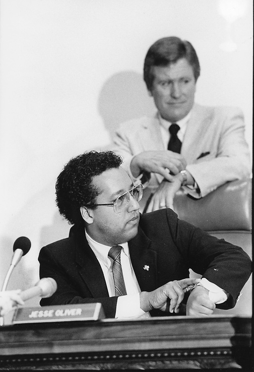 ©1989 Committee members in the Texas House checking their watches.